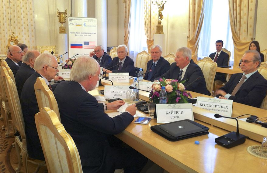 Participants in a meeting of former U.S. and Russian envoys in Moscow on Sunday, March 31, 2013, include (from left) Alexander Vershbow, Thomas Pickering, Jack Matlock, James Collins and John Beyrle, all former U.S. ambassadors to Russia or the Soviet Union; (on the right side of the table) Vladimir Lukin, former Russian ambassador to the U.S.; Yuri Dubinin, former Soviet ambassador to U.S.; former Russian Ambassador to Poland Leonid Drachevsky; Sergei Rogov, director of the Institute for the U.S. and Canadian Studies; and Alexander Bessmertnykh, former Soviet ambassador to U.S.