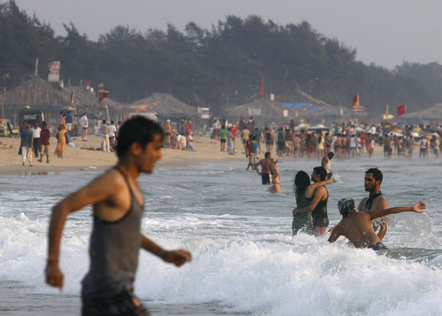 Beachgoers play on Baga Beach in Goa, India, a popular destination with Indian and foreign tourists, on Saturday, March 9, 2013. (AP Photo/ Rajesh Kumar Singh)