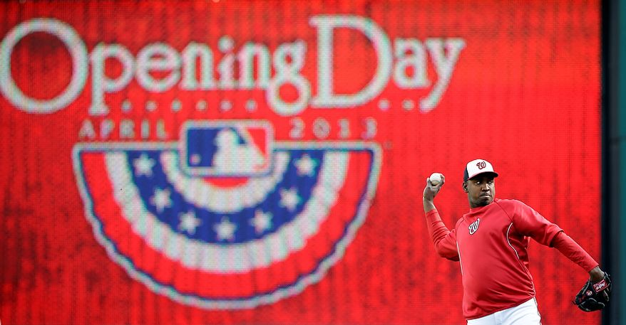 Washington Nationals relief pitcher Rafael Soriano warms up before an opening day baseball game against the Miami Marlins in Washington, on Monday, April 1, 2013.  (AP Photo/Alex Brandon)