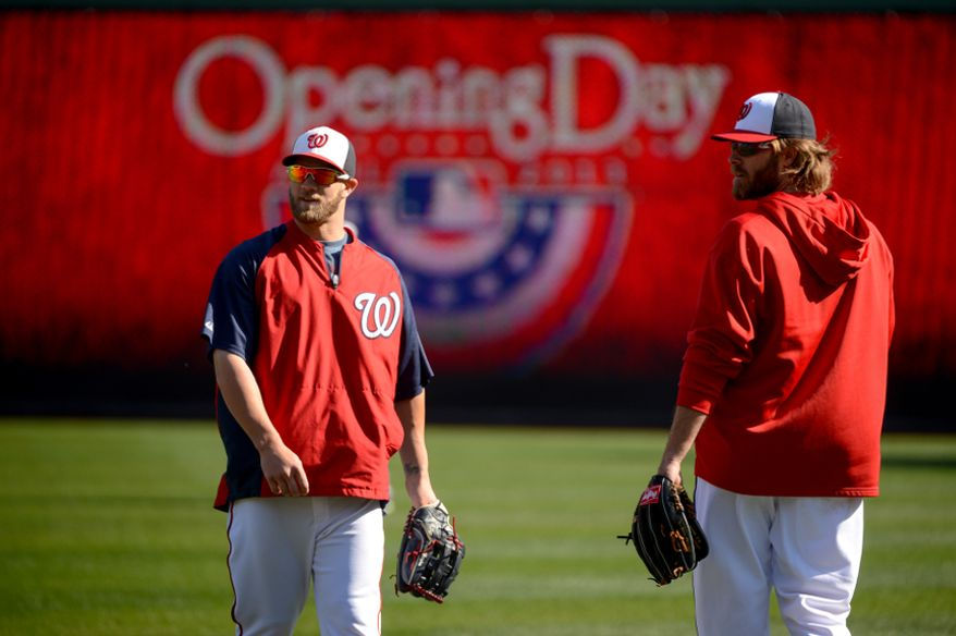 Washington Nationals left fielder Bryce Harper (34), left, and Washington Nationals right fielder Jayson Werth (28), right, warm up with the team before the Washington Nationals play the Miami Marlins on opening day at Nationals Park, Washington, D.C., Monday, April 1, 2013. (Andrew Harnik/The Washington Times)