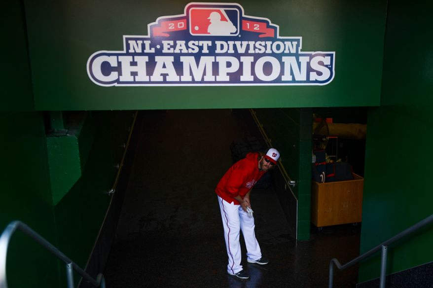 Washington Nationals right fielder Jayson Werth (28) looks out on the field as he heads to the locker room before the Washington Nationals play the Miami Marlins on opening day at Nationals Park, Washington, D.C., Monday, April 1, 2013. (Andrew Harnik/The Washington Times)