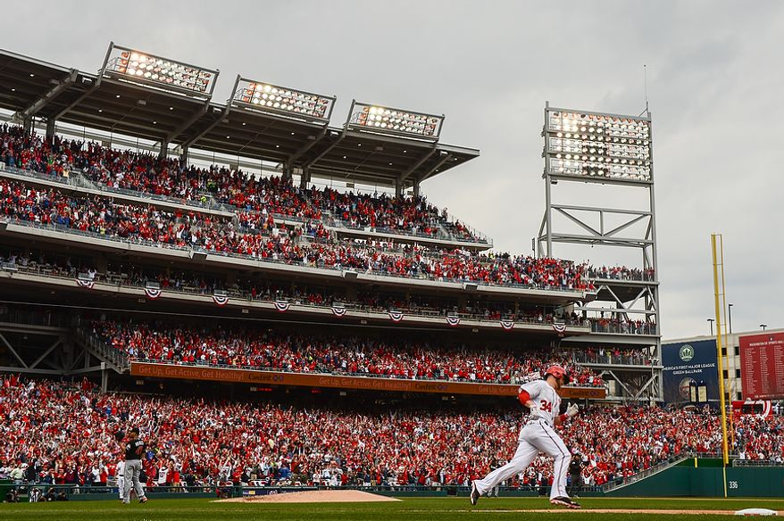 Washington Nationals left fielder Bryce Harper (34) rounds  first base as he hits his second home run of the game in the bottom of the 4th inning as the Washington Nationals play the Miami Marlins on opening day at Nationals Park, Washington, D.C., Monday, April 1, 2013. (Andrew Harnik/The Washington Times)