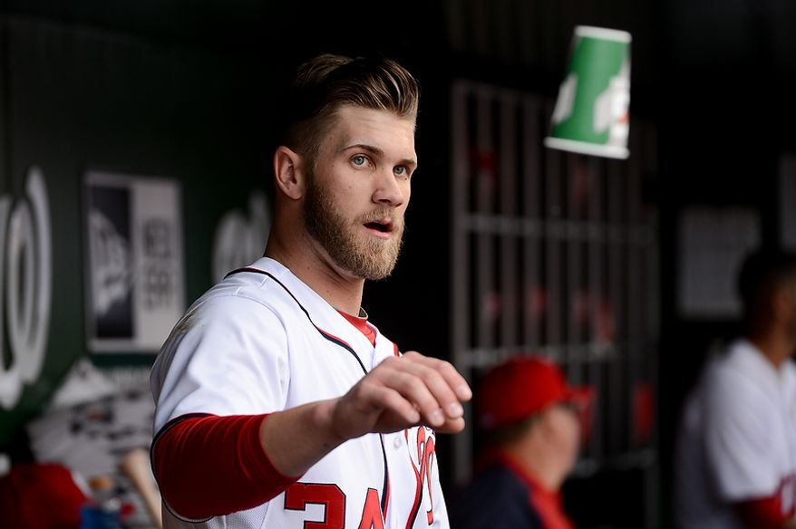 Washington Nationals left fielder Bryce Harper (34) in the dugout after hitting a solo home run in the first inning as the Washington Nationals play the Miami Marlins on opening day at Nationals Park, Washington, D.C., Monday, April 1, 2013. (Andrew Harnik/The Washington Times)