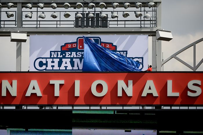A large poster celebrating the Washington Nationals playoff run of last year is unveiled behind the large screen in centerfield before the Washington Nationals play the Miami Marlins on opening day at Nationals Park, Washington, D.C., Monday, April 1, 2013. (Andrew Harnik/The Washington Times)