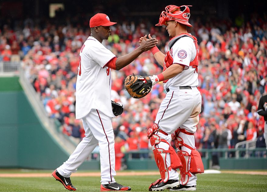 Washington Nationals relief pitcher Rafael Soriano (29) celebrates with Washington Nationals catcher Wilson Ramos (40) as the Washington Nationals beat the Miami Marlins 2-0 on opening day at Nationals Park, Washington, D.C., Monday, April 1, 2013. (Andrew Harnik/The Washington Times)