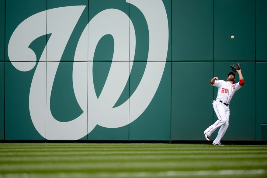 Washington Nationals right fielder Jayson Werth (28) catches a pop fly for the second out at the top of the 4th inning as the Washington Nationals play the Miami Marlins on opening day at Nationals Park, Washington, D.C., Monday, April 1, 2013. (Andrew Harnik/The Washington Times)