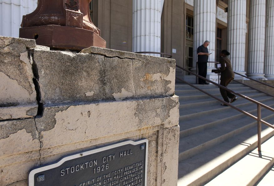 **FILE** A light standard rests at the dilapidated entrance to city hall in Stockton, Calif., on June 26, 2012. (Associated Press)