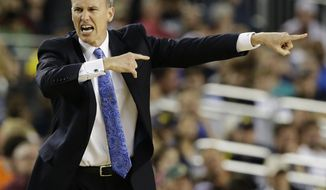 Florida Gulf Coast head coach Andy Enfield reacts to action against Florida during the second half of a regional semifinal game in the NCAA college basketball tournament, Saturday, March 30, 2013, in Arlington, Texas. (AP Photo/David J. Phillip)