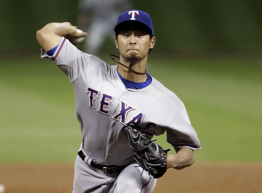 Texas Rangers' Yu Darvish delivers a pitch against the Houston Astros in the fifth inning of a baseball game Tuesday, April 2, 2013, in Houston. (AP Photo/Pat Sullivan)