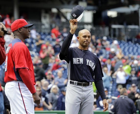 New York Yankees relief pitcher Mariano Rivera, center raises his cap during a presentation before an exhibition baseball game at Nationals Park on Friday, March 29, 2013, in Washington. Washington Nationals relief pitcher Rafael Soriano is at left, (AP Photo/Alex Brandon)