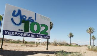 **FILE** A campaign placard for Proposition 102, defining marriage as a union between one man and one woman, is set up at an intersection on Oct. 10, 2008, in Phoenix. (Associated Press)