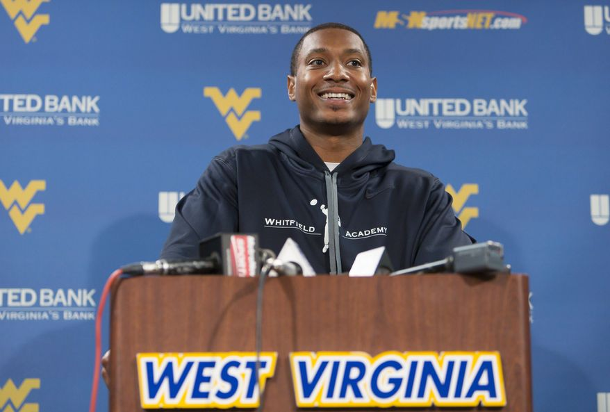 Former West Virginia quarterback Pat White speaks to the media during West Virginia University football Pro Day in Morgantown, W.Va., on Thursday, March 14, 2013. (AP Photo/David Smith)