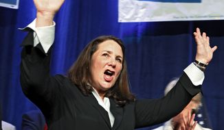 **FILE** U.S. Rep. Diana DeGette, Colorado Democrat, waves to supporters at an election party at the Sheraton Hotel in Denver on Nov. 6, 2012. (Associated Press)