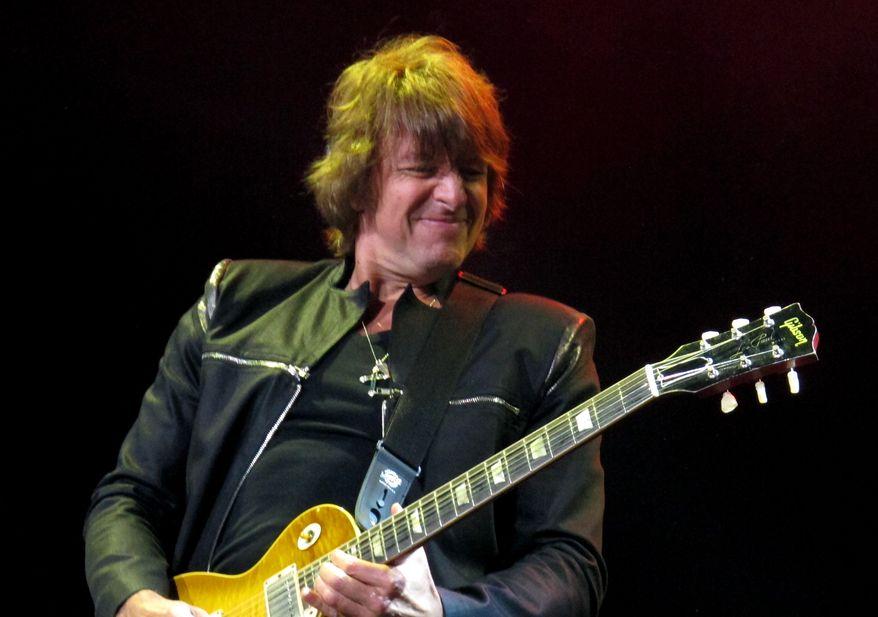 Bon Jovi guitarist Richie Sambora performs at the Bamboozle Festival in Asbury Park, N.J., on Sunday, May 20, 2012. (AP Photo/Wayne Parry)
