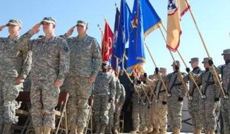 ** FILE ** Soldiers and members of a joint color guard at Fort Knox take part in a ceremony commemorating Veterans Day. (U.S. Army)