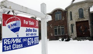 "A ""for sale"" sign is seen outside a home in Glenview, Ill., on Feb. 27, 2013. (Associated Press)"