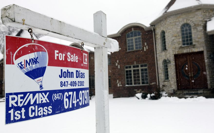 """A """"for sale"""" sign is seen outside a home in Glenview, Ill., on Feb. 27, 2013. (Associated Press)"""