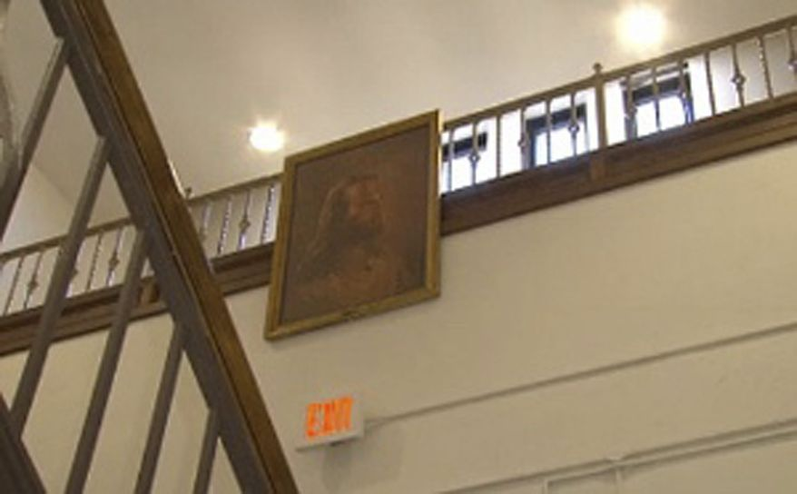 ** FILE ** In this Thursday, Feb. 7, 2013, photo, a portrait of Jesus hangs in the hallway at Jackson Middle School in Jackson, Ohio. The superintendent of the southern Ohio district facing a federal lawsuit over the Jesus portrait says it's been moved to a high school at the preference of the Christian-based student club that the district views as the picture's owner. (AP Photo/WBNS-10 TV)