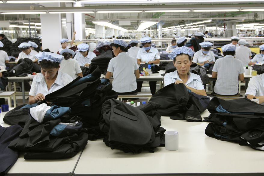 ** FILE* ** In this Sept. 21, 2012, photo, North Korean workers assemble Western-style suits at the South Korean-run ShinWon Corp. garment factory inside the Kaesong industrial complex in Kaesong, North Korea. On Wednesday, April 3, 2013, North Korea refused entry to South Koreans trying to cross the Demilitarized Zone to get to their jobs managing factories in the North Korean city of Kaesong. (AP Photo/Jean H. Lee)