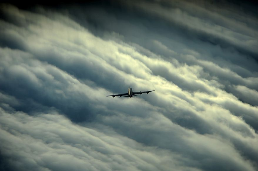 A KC-135 flies through storm clouds on its way to refuel a C-17 Globemaster off Florida's east coast on July 12, 2012. The KC-135 was the Air Force's first jet-powered refueling tanker and replaced the KC-97 Stratotanker.   (U.S. Air Force photo by Tech. Sgt. Jeremy T. Lock)