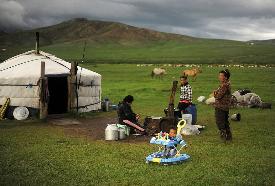 Herders live in a traditional Mongolian dwelling called a Ger. It is suited for the harsh terrain and lifestyle the herders live. The Ger is a round felt tent covered in durable, waterproof, white canvas and is designed to be able to pack up and move. Its round shape keeps the Ger resilient to Mongolia 's ferocious winds, while its felt is rapidly drying material for when it rains or snow melts.  (U.S. Air Force photo by Tech. Sgt. Jeremy T. Lock)