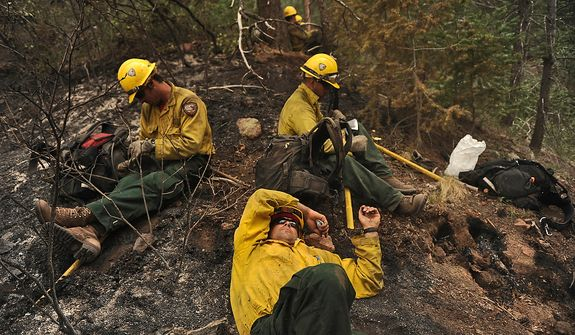 Firefighters from the Vandenberg Air Force Base, Calif., Hot Shots take a lunch break while clearing a fire line in the Mount Saint Francois area of Colorado Springs, Colo., June 28, 2012.  (U.S. Air Force photo by Tech. Sgt. Jeremy T. Lock)