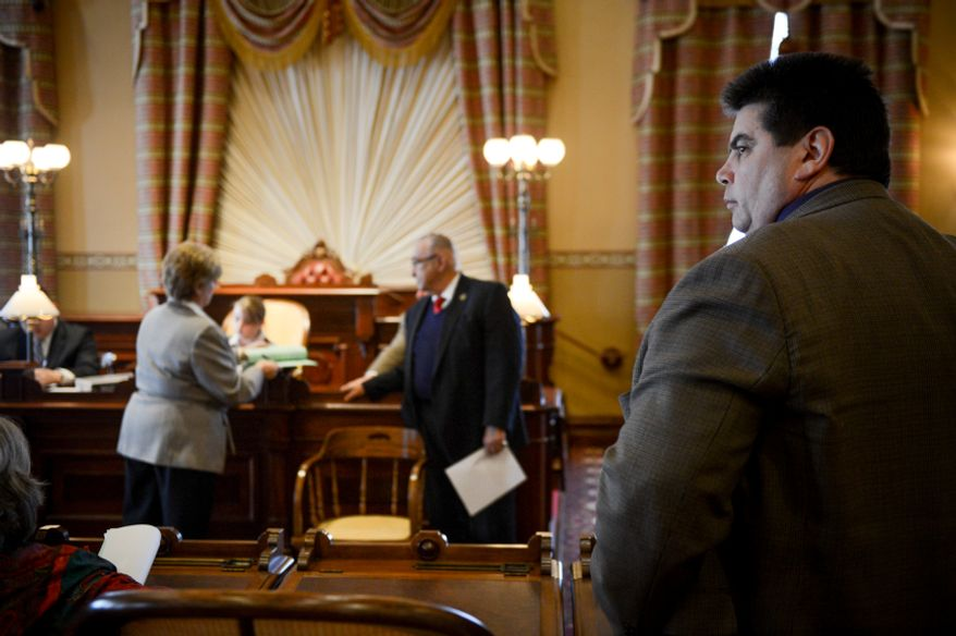 Del. Michael Smigiel Sr. (R-District 36), right, stands during an emergency House Judiciary Committee Hearing held by Vice Chair Kathleen Dumais (D-District 15), left, and Chairman Joseph Vallario, Jr. (D-District 27A), center, inside the Old House Chambers to debate three of the top gun legislation amendments before the Maryland House of Delegates votes on a gun-control measure at the Maryland State House, Wednesday, April 3, 2013. (Andrew Harnik/The Washington Times)