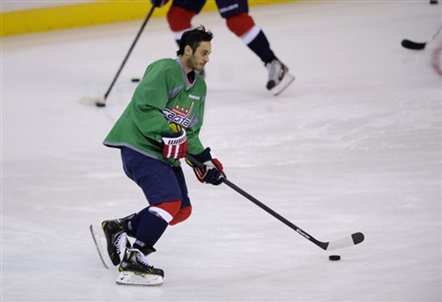 Washington Capitals center Mike Ribeiro (9) skates with the puck during warmups before an NHL hockey game against the Buffalo Sabres, Sunday, March 17, 2013, in Washington. (AP Photo/Nick Wass)