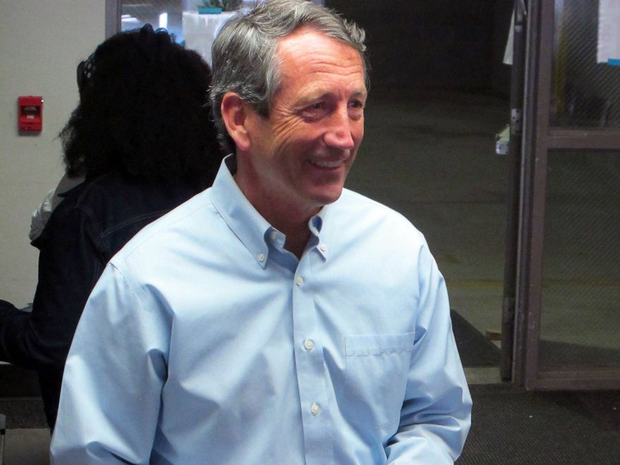 Former South Carolina Gov. Mark Sanford leaves the voting booth after voting at his precinct in Charleston, S.C., on Tuesday, April 2, 2013. (AP Photo/Bruce Smith)