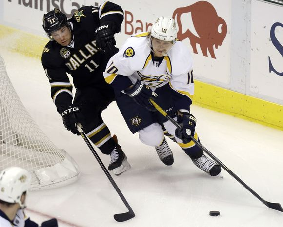 Nashville Predators left wing Martin Erat (10) skates with the puck against Dallas Stars center Derek Roy (11) during the first period of an NHL hockey game, Tuesday, March 12, 2013, in Dallas. (AP Photo/LM Otero)