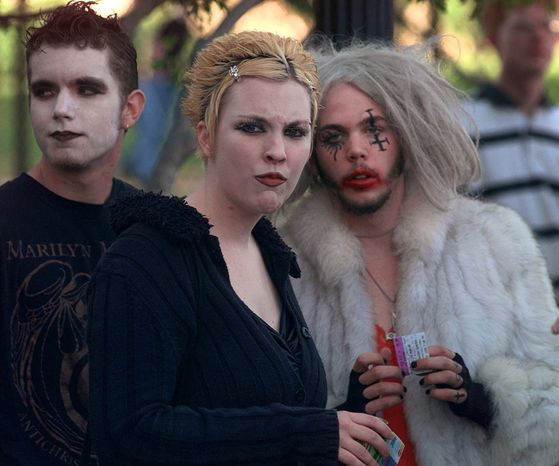 **FILE** Marilyn Manson fans wait outside the Five Seasons Center before a concert on April 28, 1999, in Cedar Rapids, Iowa. The concert went on as planned despite more than 1,400 people signing a petition urging the Cedar Rapids City Council to cancel it. (Associated Press)