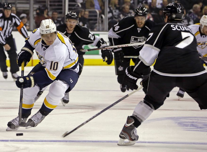 Nashville Predators left winger Martin Erat (10) and Los Angeles Kings defenseman Rob Scuderi (7) maneuver in the first period of an NHL hockey game in Los Angeles, Thursday, Jan. 31, 2013. The Predators won in a shootout, 2-1. (AP Photo/Reed Saxon)
