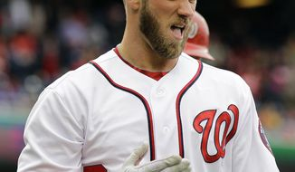 Washington Nationals' Bryce Harper reacts after sliding safely into home during the first inning of a baseball game against the Miami Marlins at Nationals Park, Thursday, April 4, 2013, in Washington. (AP Photo/Alex Brandon)