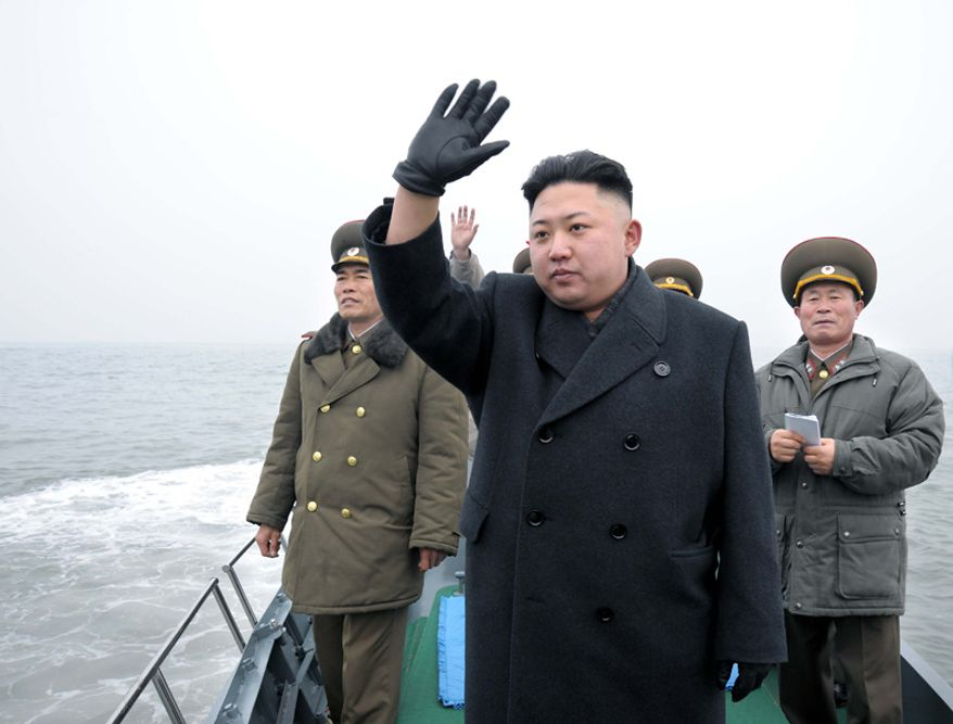 ** FILE** North Korean leader Kim Jong-un waves in this government-issued photograph.