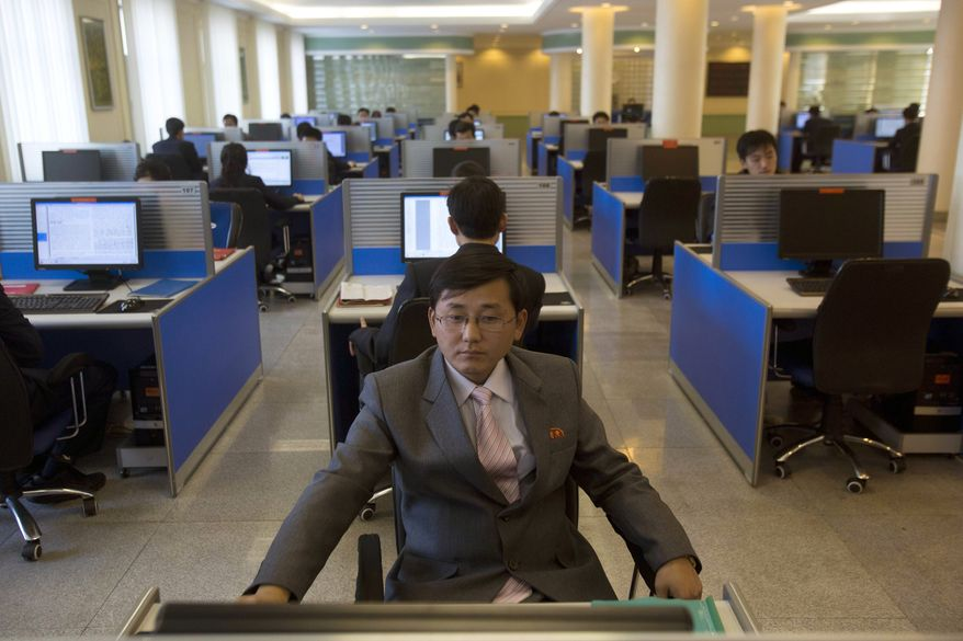 ** FILE ** A North Korean student surfs the Internet at a computer terminal in a computer lab at Kim Il-sung University in Pyongyang, North Korea, during a tour by Google Executive Chairman Eric Schmidt on Tuesday, Jan. 8, 2013. (AP Photo/David Guttenfelder)