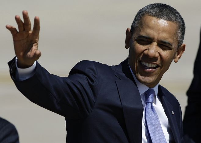 President Barack Obama waves at his arrival in Colorado for a speech on gun control. April 4, 2013.  (AP Photo/Brennan Linsley)