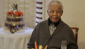 ** FILE ** Former South African President Nelson Mandela as he celebrates his 94th birthday with family in Qunu, South Africa, on July 18, 2012. Mr. Mandela just celebrated his 95th birthday on July 18, 2013, while recovering from a lung infection. (Associated Press)