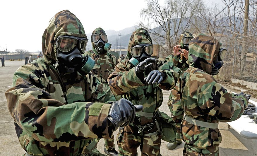 Soldiers from the U.S. Army's 23rd Chemical Battalion check their gear after a demonstration during a ceremony marking their return Thursday to the 2nd Infantry Division based at Camp Stanley in Uijeongbu, South Korea. Nearly 30,000 U.S. soldiers are stationed in South Korea.