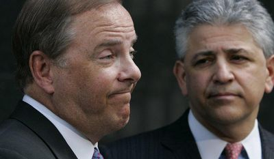 ** FILE ** Former Enron executive Jeffrey Skilling (left) and his attorney, Dan Petrocelli, leave the courthouse in Houston after the verdict in his fraud and conspiracy trial on May 25, 2006. (AP Photo/Pat Sullivan)