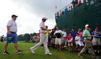 Dustin Johnson walks away from the practice green during the 2012 Tour Championship at East Lake Golf Course in Atlanta, where he tied for third with Sergio Garcia. (Sara Caldwell / The Augusta Chronicle)