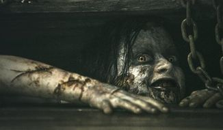 "This film image shows a scene from ""Evil Dead."" (AP Photo/Sony-TriStar Pictures)"