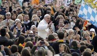 ** FILE ** Pope Francis salutes as he arrives for his weekly general audience in St. Peter Square at the Vatican Wednesday, April 3, 2013. (AP Photo/Alessandra Tarantino)