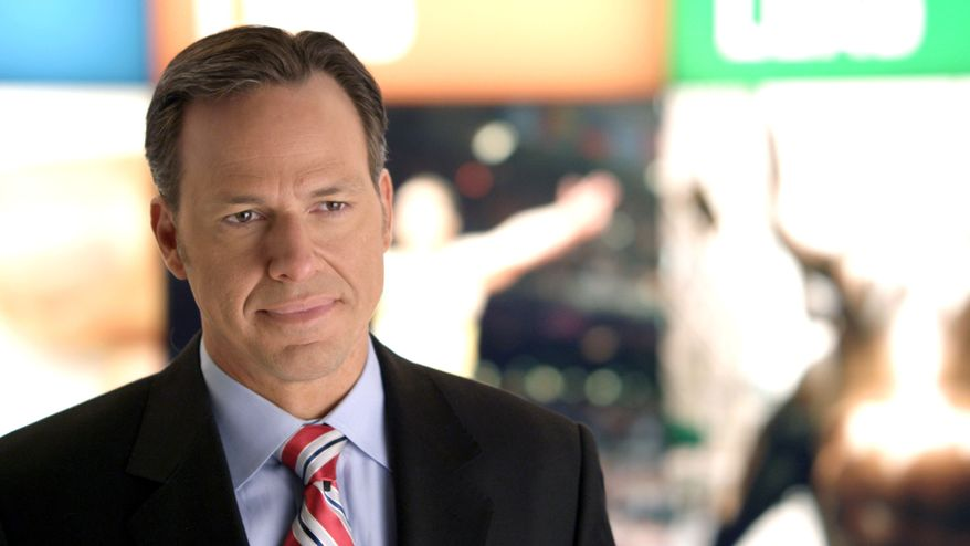 "CNN's Jake Tapper works on the set of his show ""The Lead with Jake Tapper."" (Associated Press/CNN) ** FILE **"