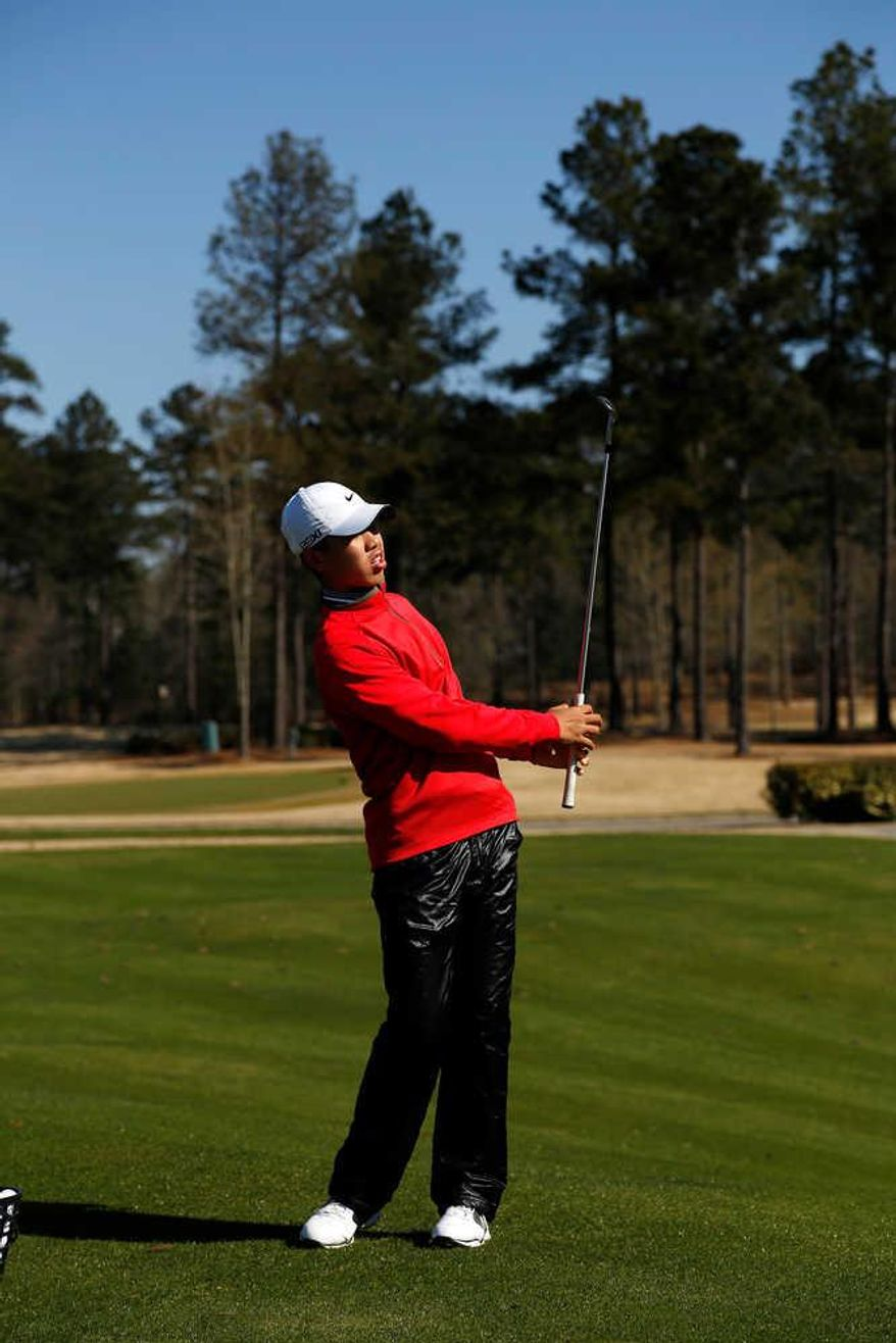 Tianlang Guan, who will be the youngest competitor in Masters history at age 14, works on his game at Champions Retreat Golf Club in Evans. (Todd Bennett  / The Augusta Chronicle)