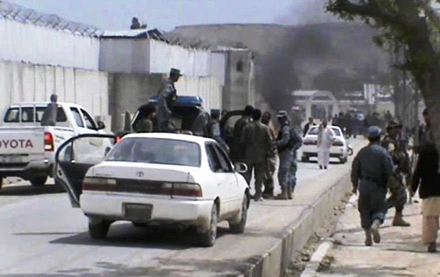 This image made from AP video shows the scene moments after a car bomb exploded in front of the Provincial Reconstruction Team in Qalat in Afghanistan's Zabul province on Saturday, April 6, 2013. Six American troops and civilians and an Afghan doctor were killed in attacks on Saturday in southern and eastern Afghanistan as the U.S. military's top officer began a weekend visit to the country, officials said. (AP Photo via AP video)