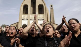 ** FILE ** Egyptian Christians chant anti-Muslim Brotherhood slogans following a funeral service at the St. Mark Coptic Cathedral in Cairo on Sunday, April 7, 2013. (AP Photo/Amr Nabil)