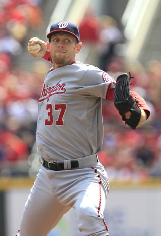 Washington Nationals pitcher Stephen Strasburg throws against the Cincinnati Reds in the first inning of their baseball game in Cincinnati, Sunday, April 7, 2013. (AP Photo/Tom Uhlman)