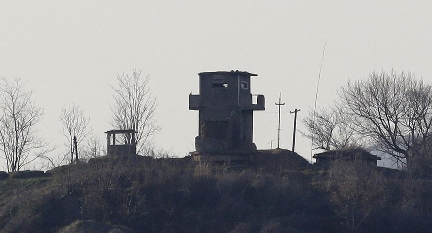 A North Korean military guard post is seen near the border village of Panmunjom, which has separated the two Koreas since the Korean War, in Paju, north of Seoul, on Sunday, April 7, 2013. (AP Photo/Lee Jin-man)