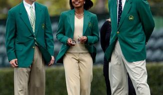Former Secretary of State Condoleezza Rice walks with fellow Augusta National members at the practice facility. Rice became a member of Augusta National last year. (Jeff Janowski  / Special to The Augusta Chronicle)