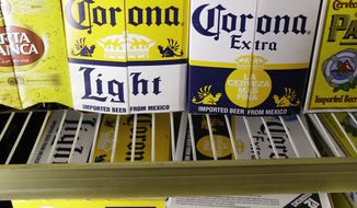 **FILE** Constellation Brands Corona beers are displayed at a liquor store in Palo Alto, Calif., on June 27, 2011. (Associated Press)